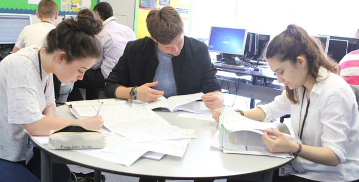 sixth form sutdents studying round a table
