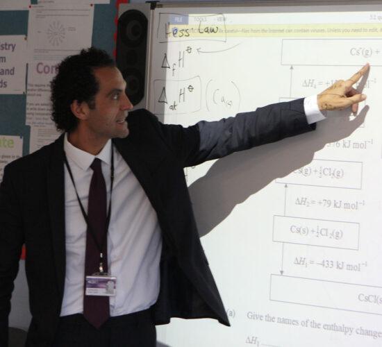 teacher at white board